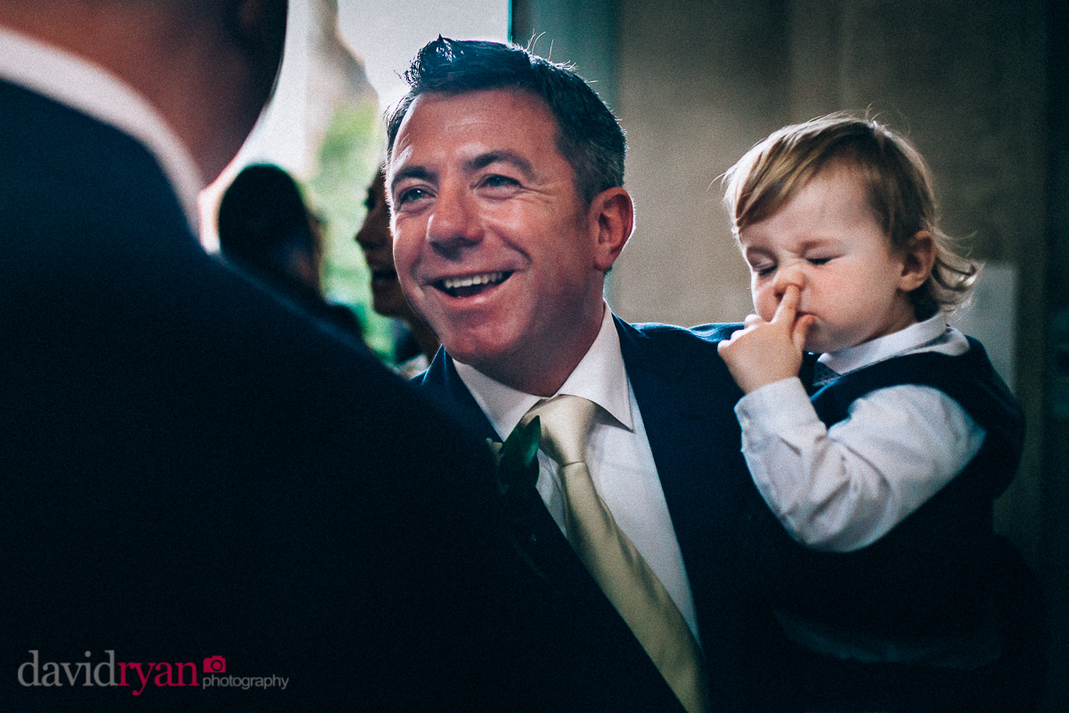 boy picking his nose at a wedding