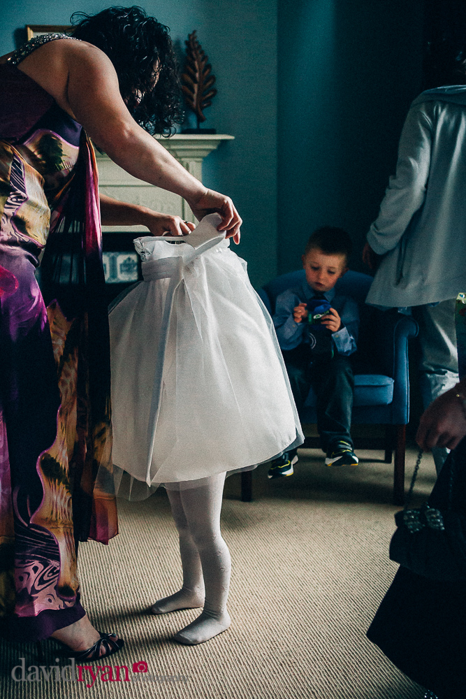 flower girl getting dressed in bansha