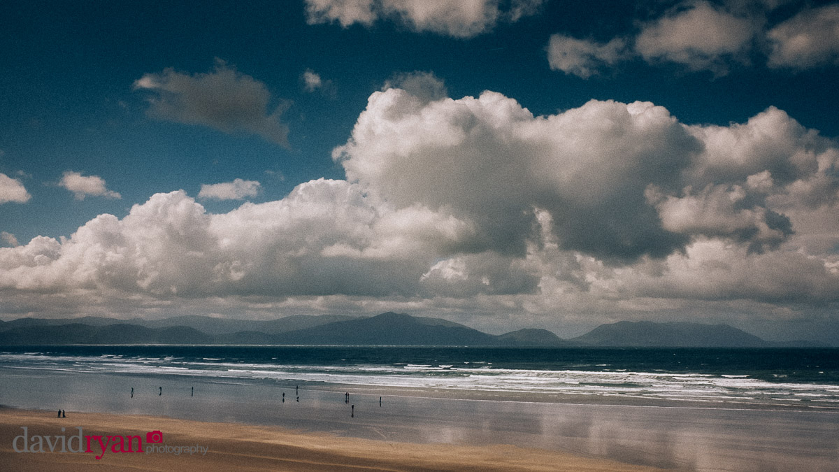 people walking on inch beach in co. kerry