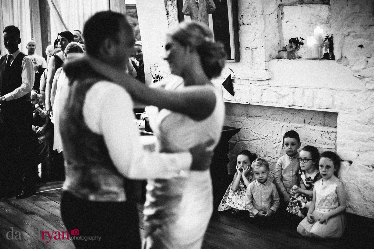 bride and groom having their first dance at the ice house in ballina