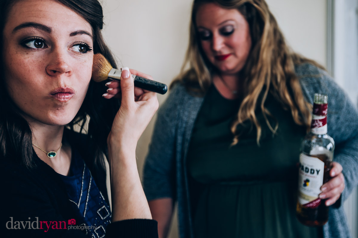 putting make up on