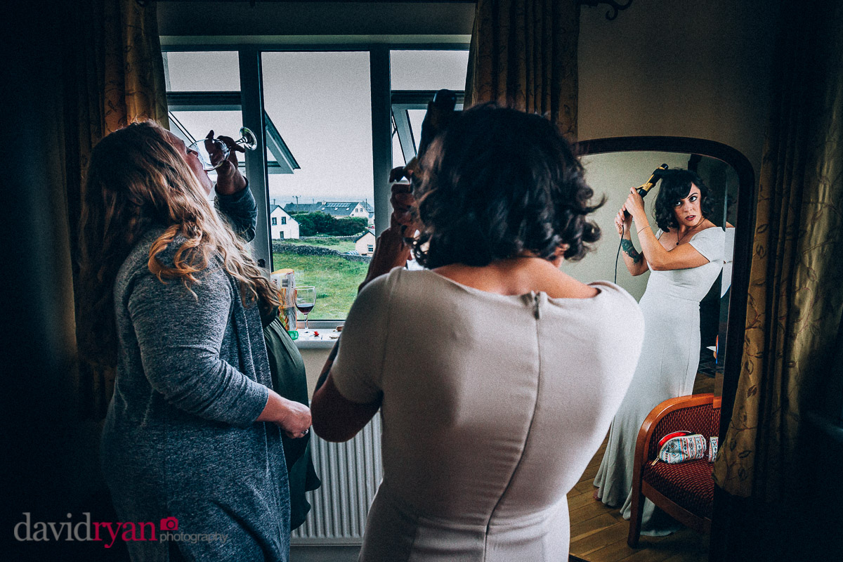 bride looking in miror on inis oirr