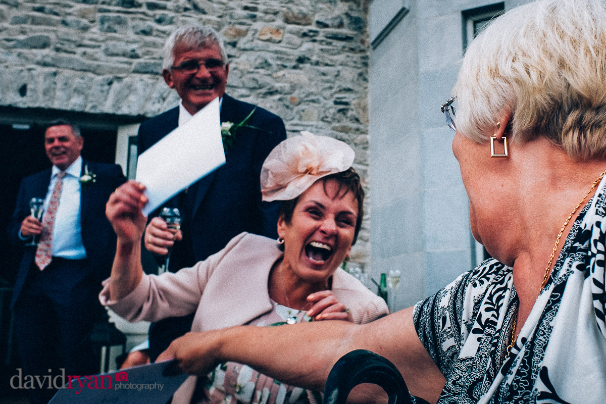 mother of the bride laughing at speech at virginia park lodge wedding