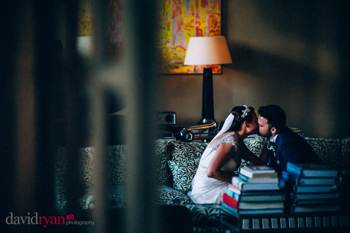 the bride and groom kiss in lounge at virginia park lodge