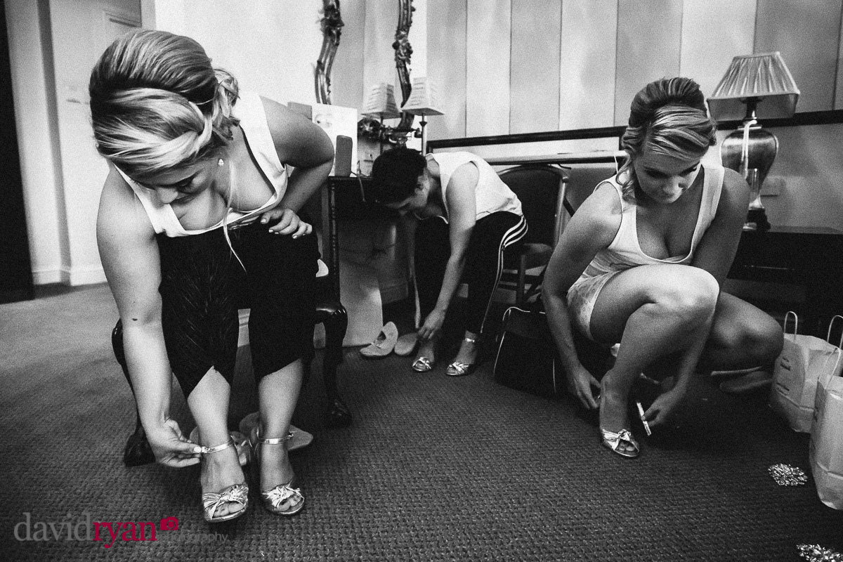 the bridesmaids buckle up their shoes at a dublin wedding