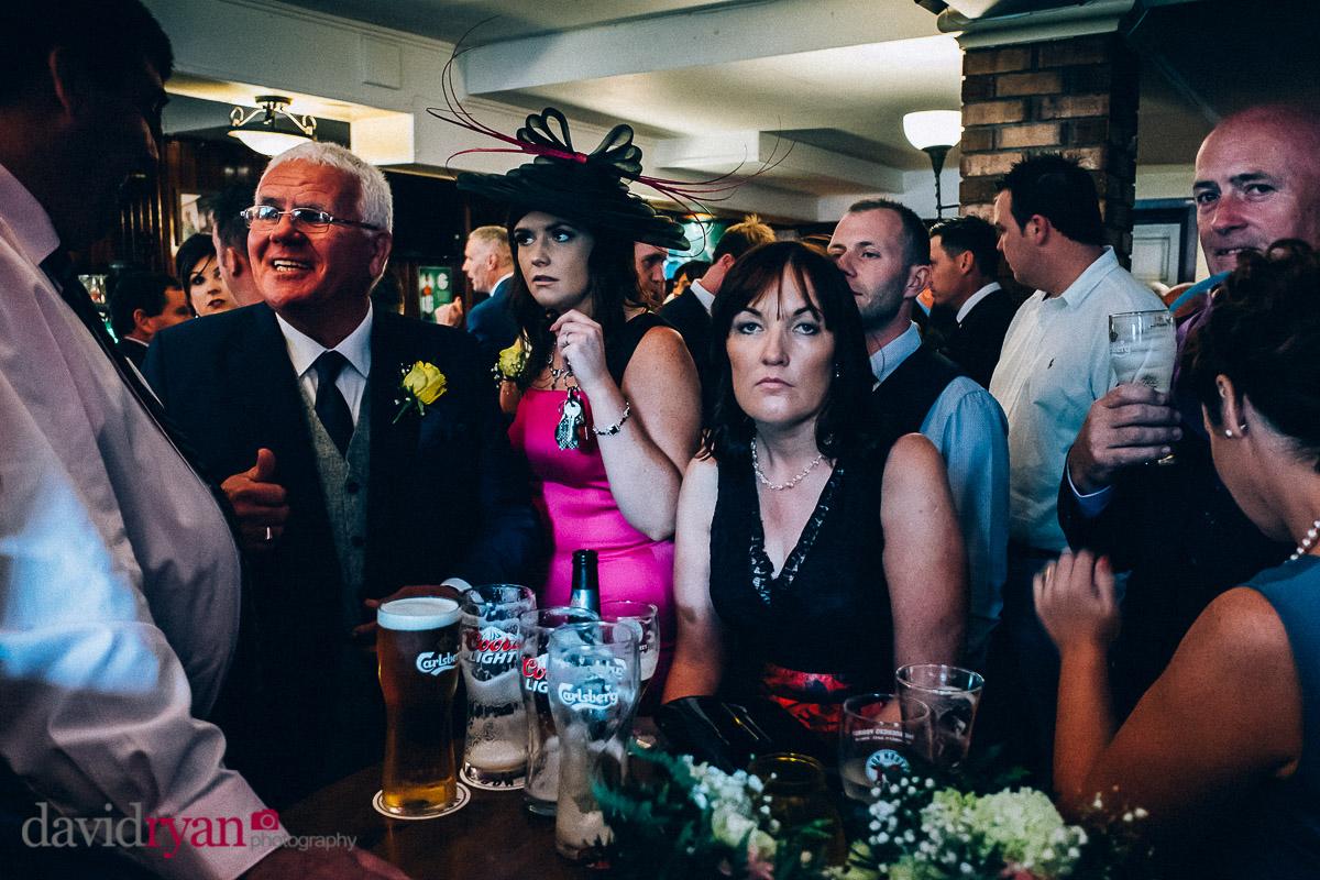 bored wedding guest in an Irish pub