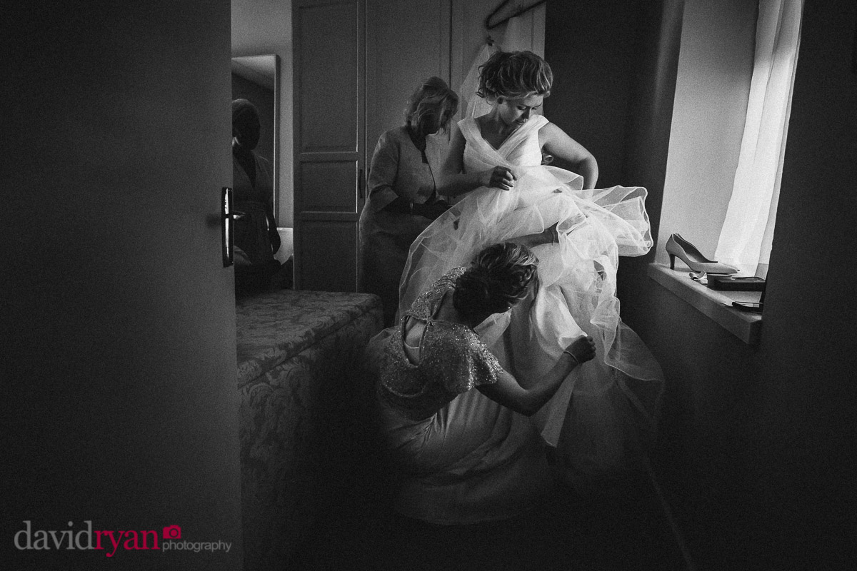 bride geting into her dress