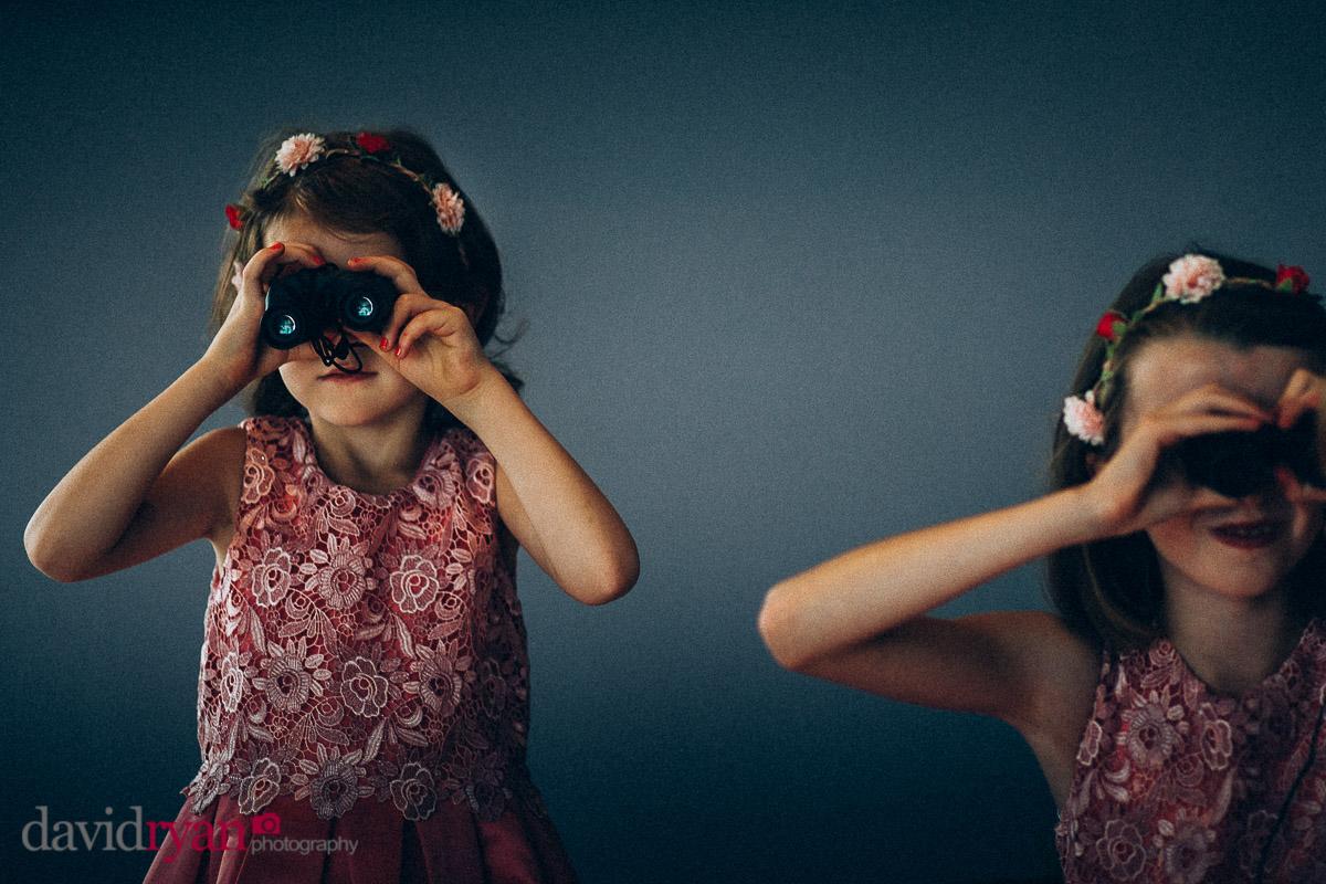 two girls with binoculars