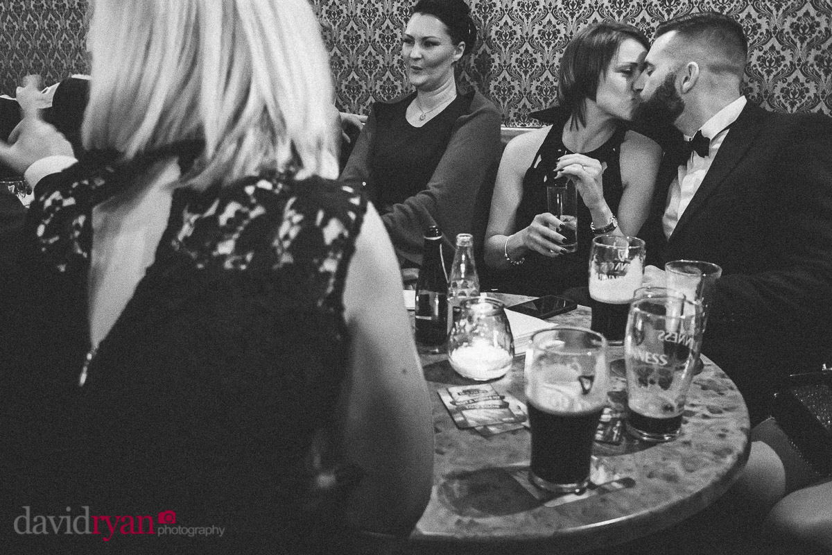 couple kissing in pub