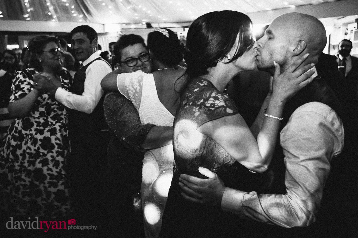 couple kissing on dancefloor