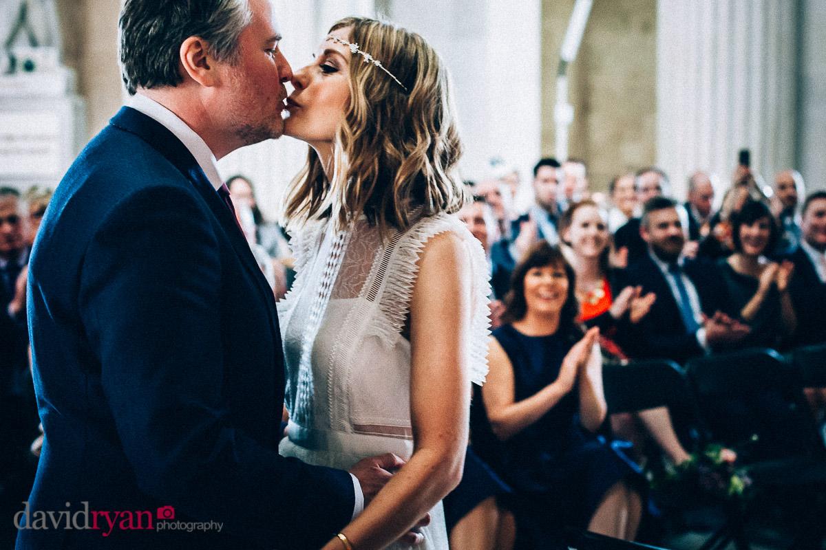 groom kissing his bride at city hall dublin wedding