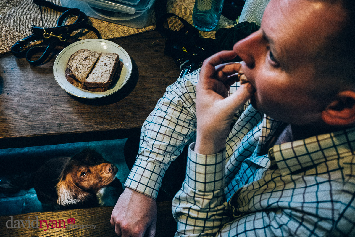 man eating a sausage sambo
