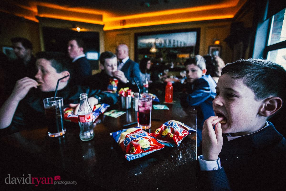 boys eating crisps