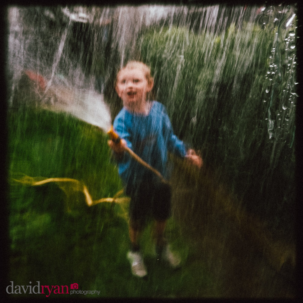 boy with hose pipe