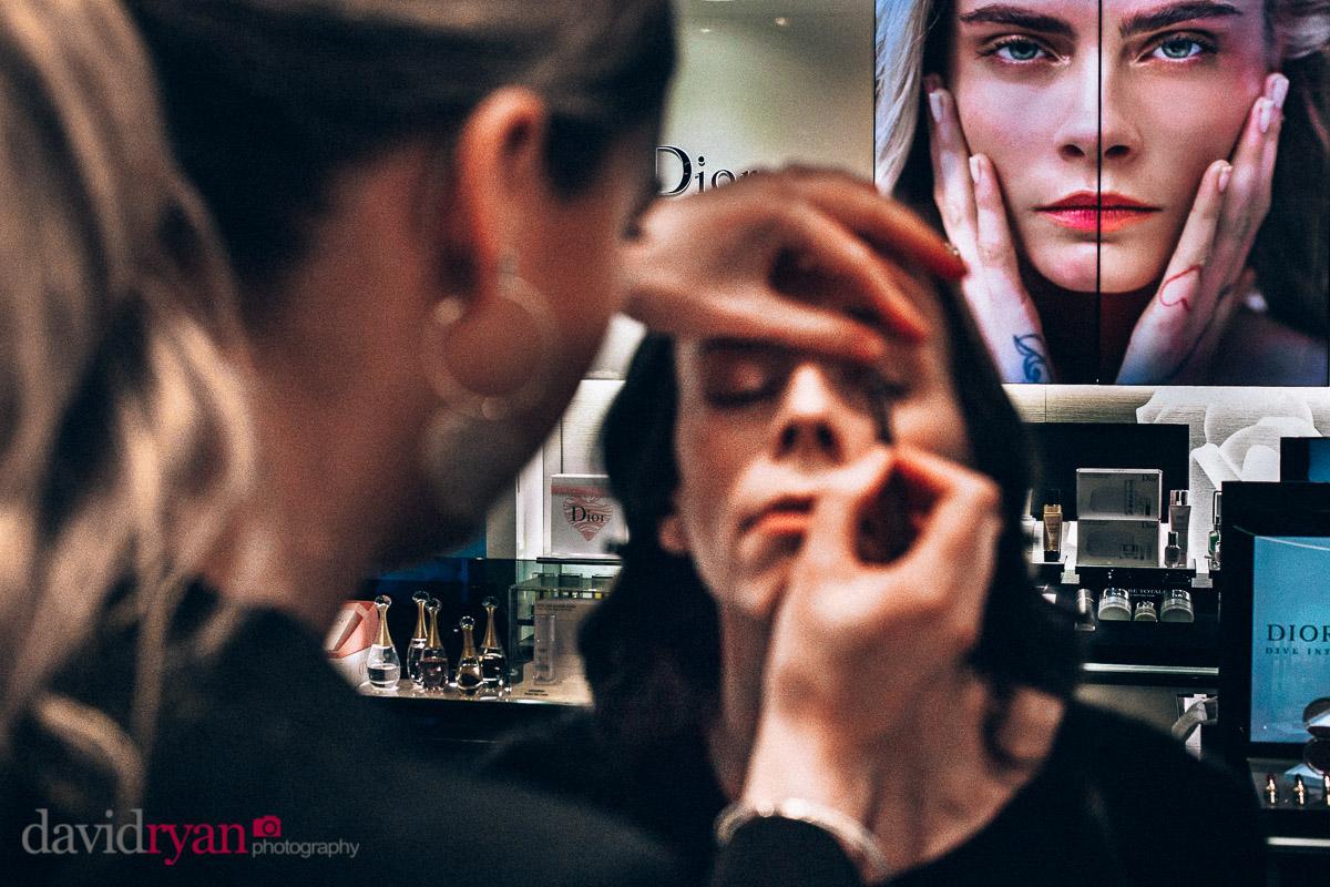 girl having her make up applied