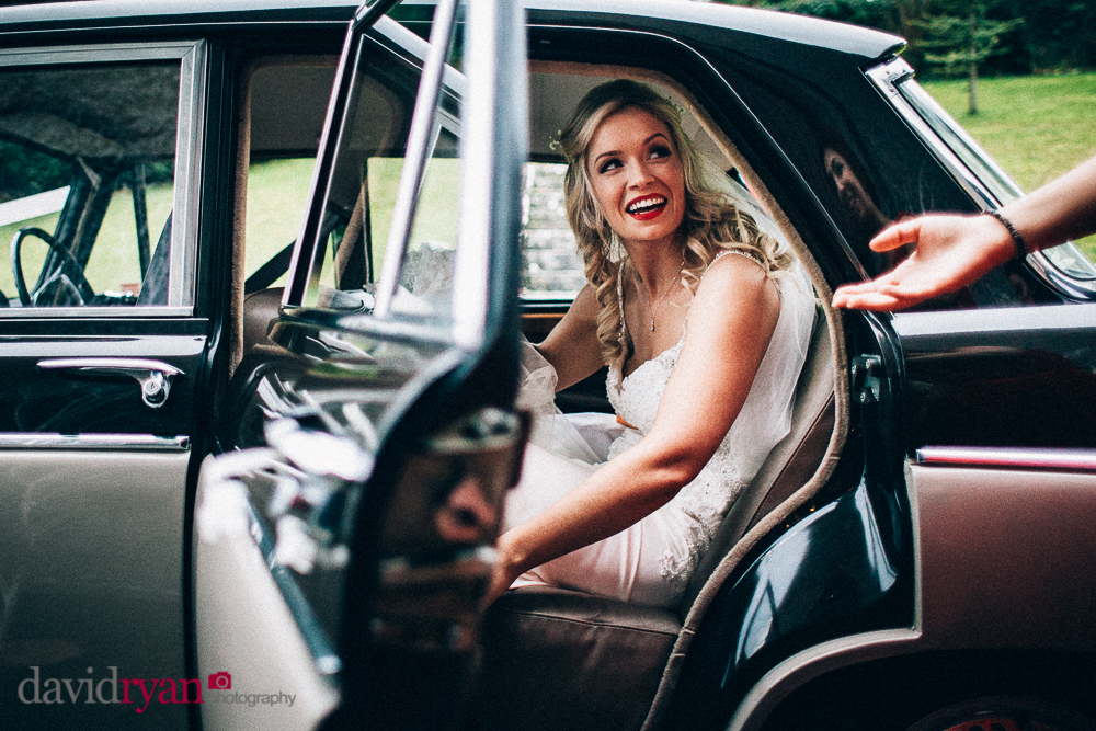 the bride arrives at Taughmaconnell  church in her vintage car