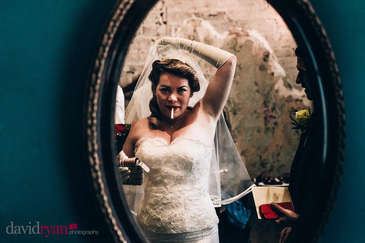 sexy bride smoking cigarette before wedding