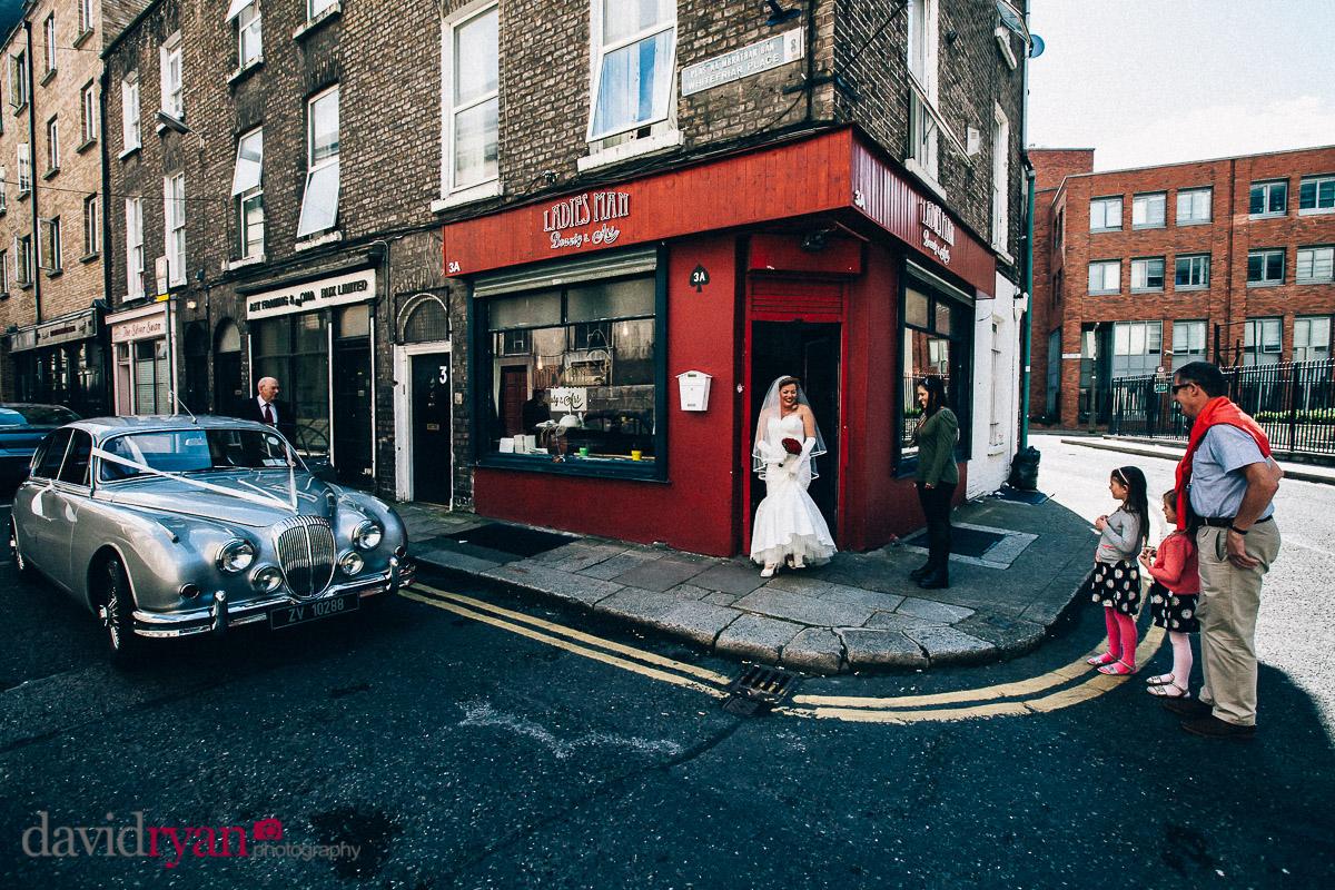 bride leaving hair salon fior her wedding in dublin