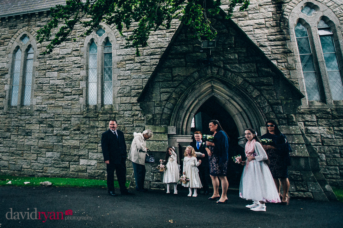 guests waiting for bride at church in tallaght