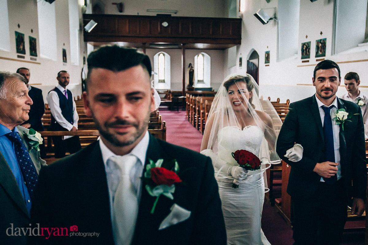 bride walking up aisle to her husband in dublin