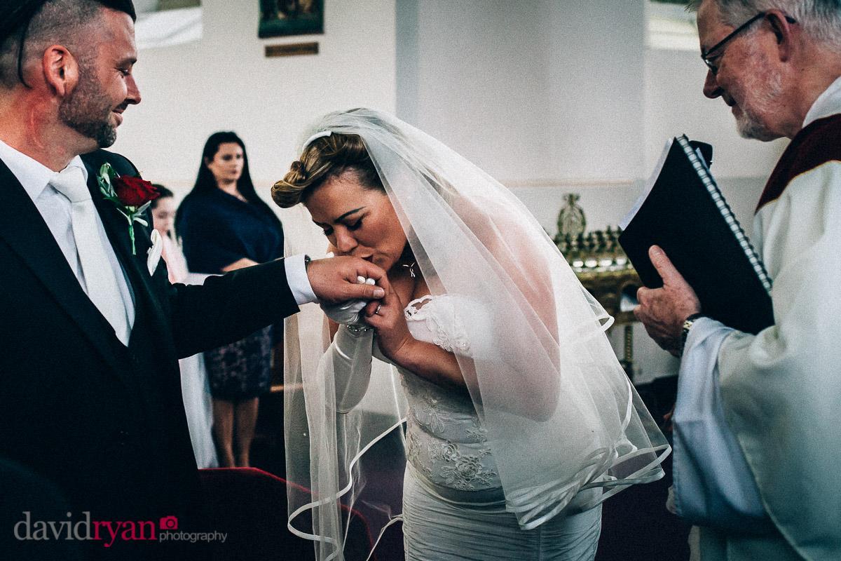 bride kisses grooms hand in dublin