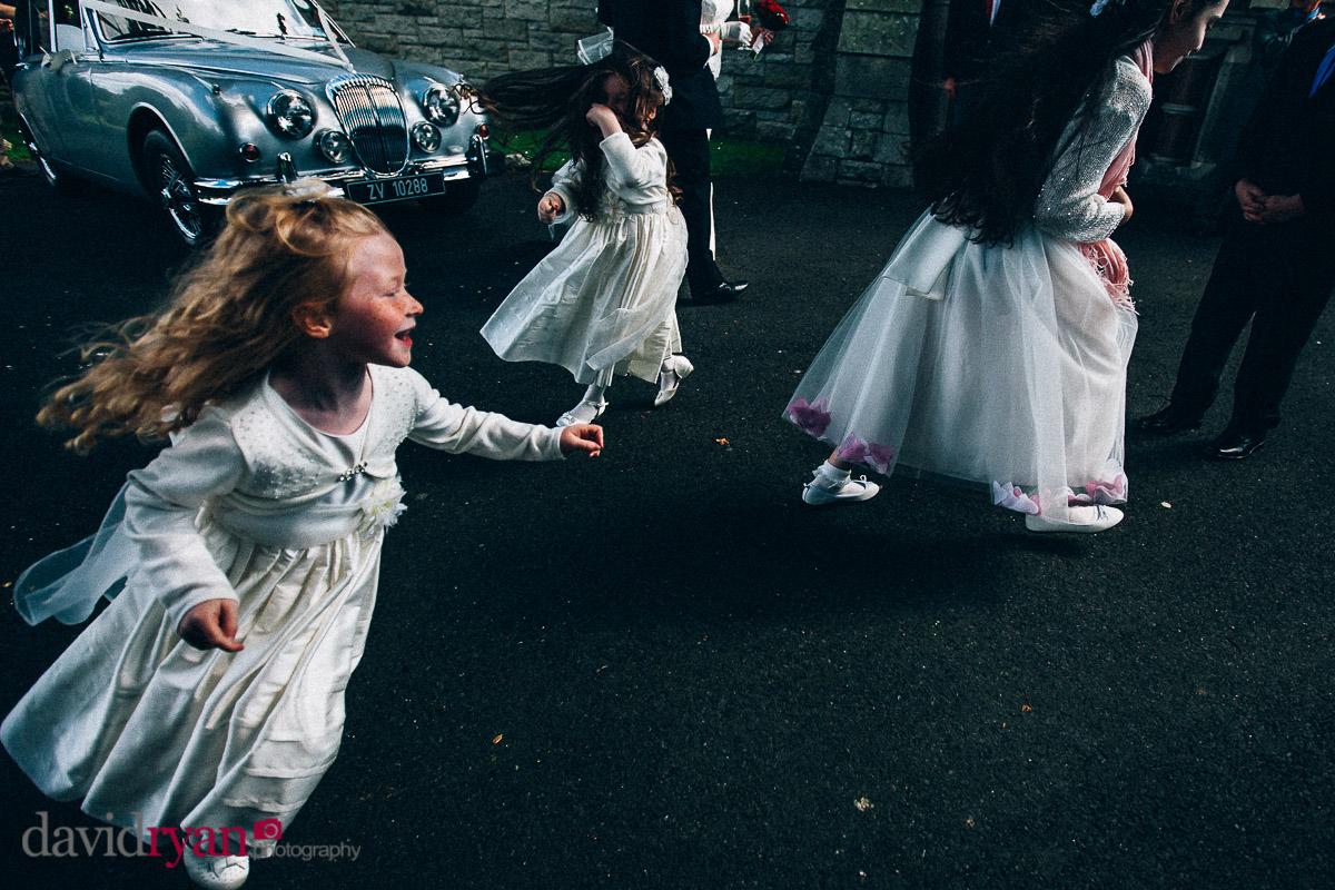 flower girls running outside dublin church