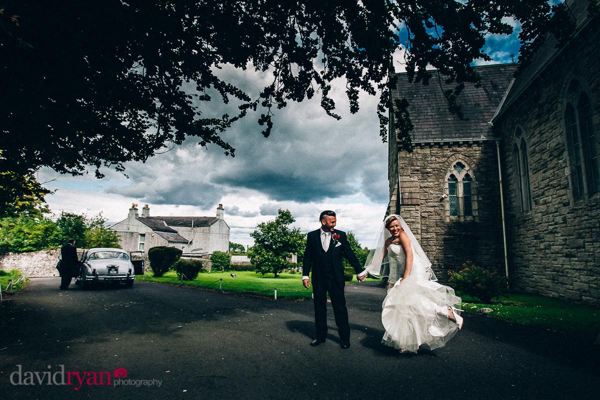 bride and groom with a mark 2 jaguar wedding car in dublin