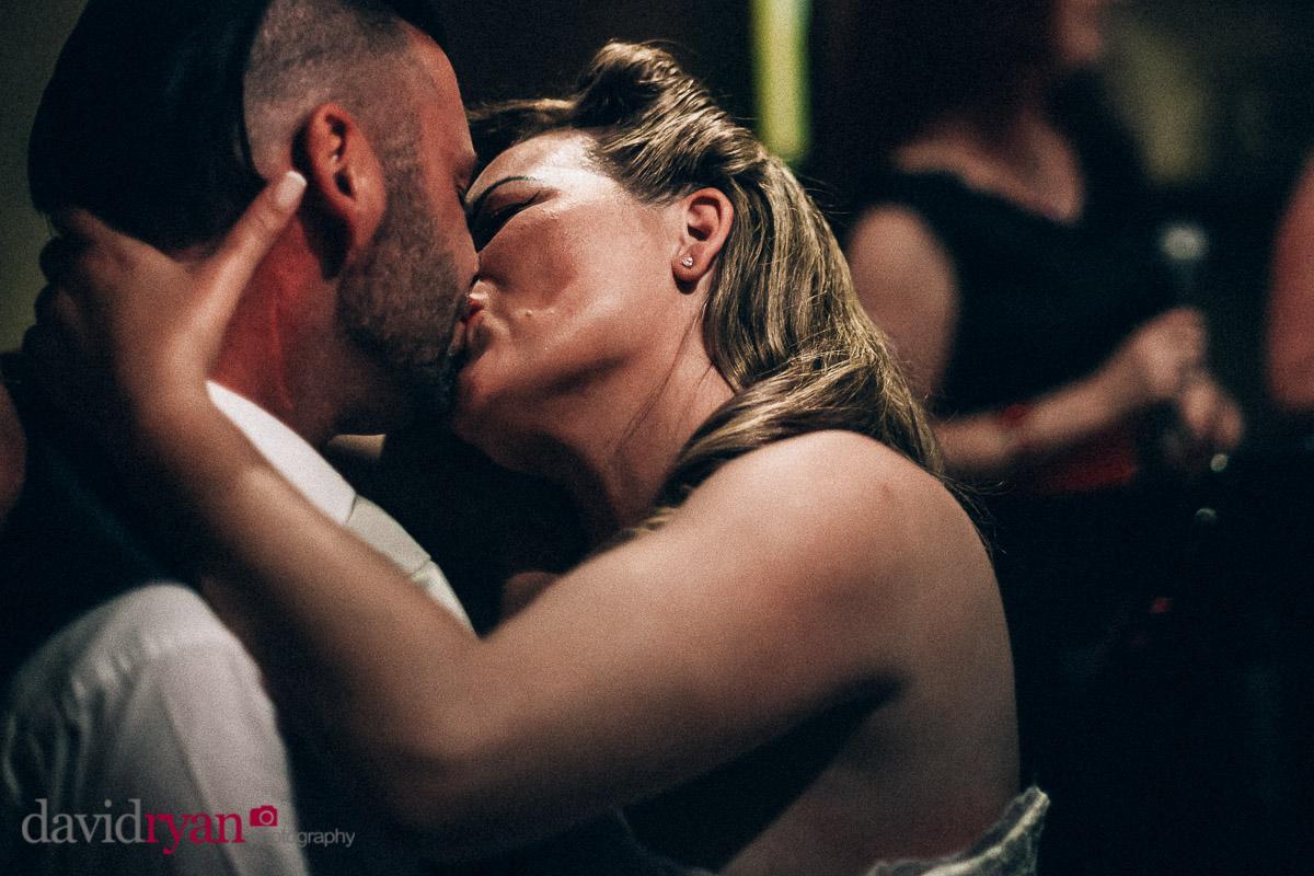 couple share a kiss on dancefloor at dublin wedding