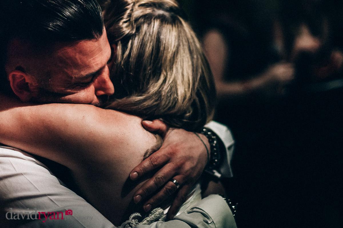 married couple embrace on dancefloor in dublin