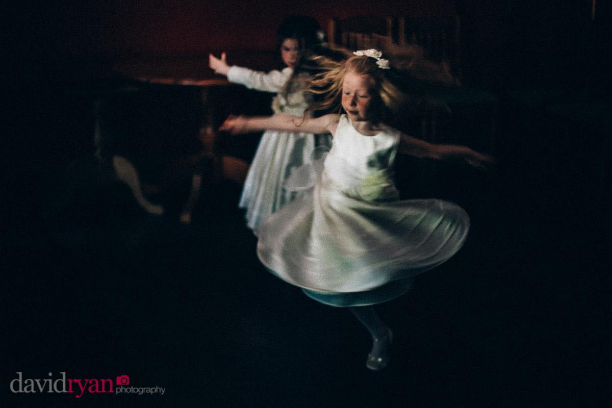 flower girls dancing on dancefloor in dublin at slow shutter