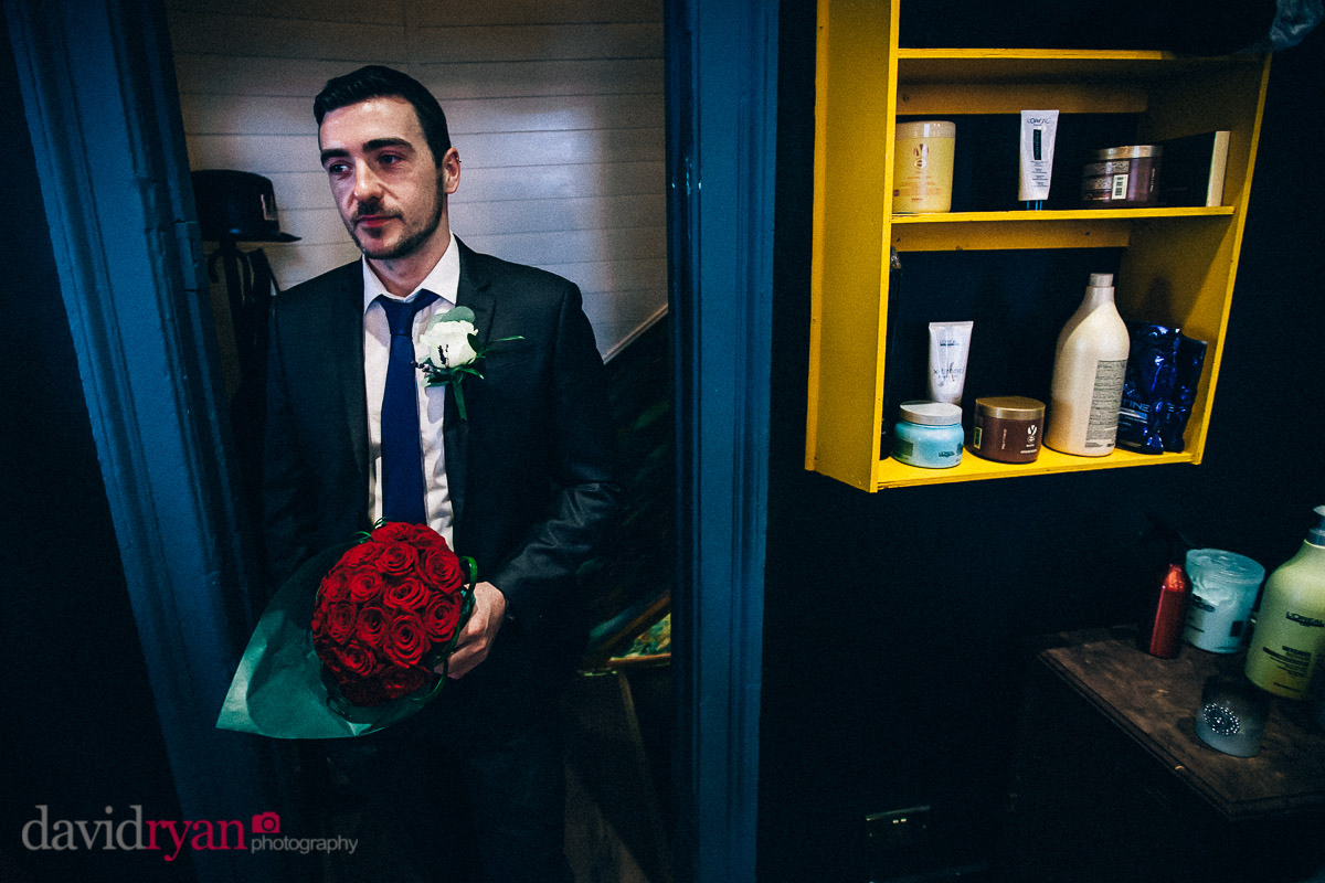 brides brother with wedding flowers