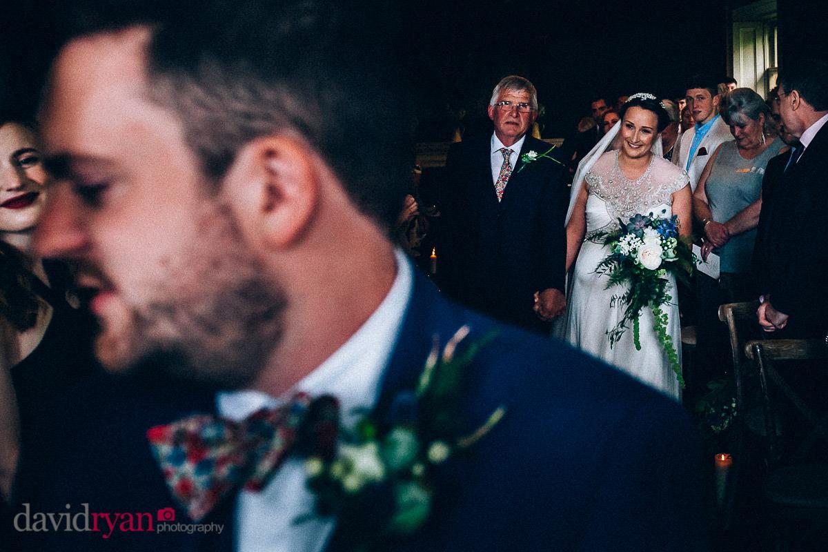 the bride coming up aisle at virginia park lodge
