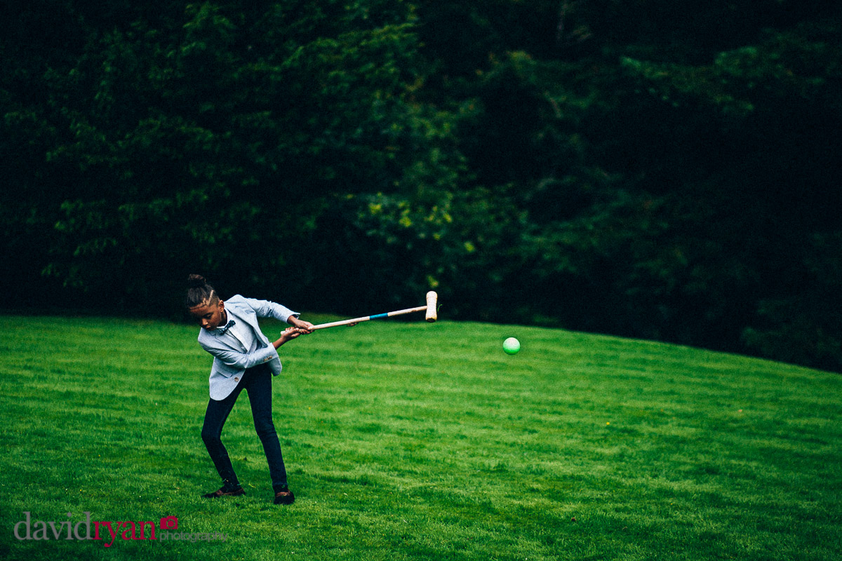 boy plays croquet on the lawn at virginia park lodge