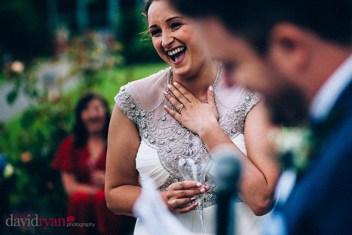 the bride laughing at groom's speech at virginia park lodge