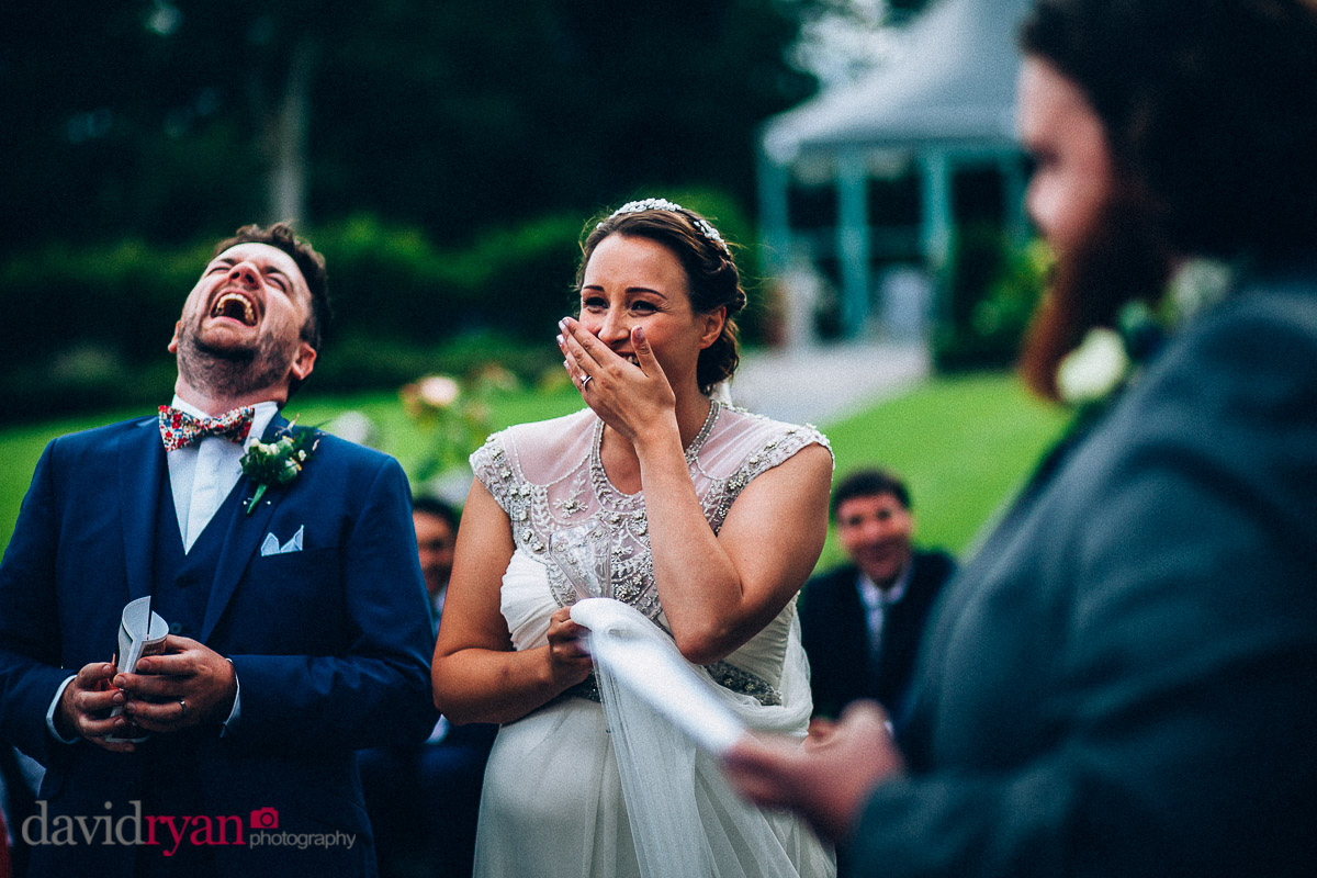 bride and groom laugh at best man's speech at virginia park lodge