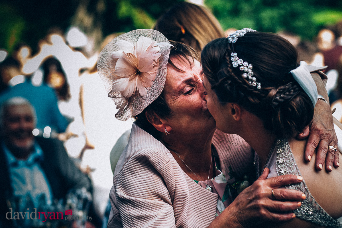 mother of the bride kisses her daughter at virginia park lodge