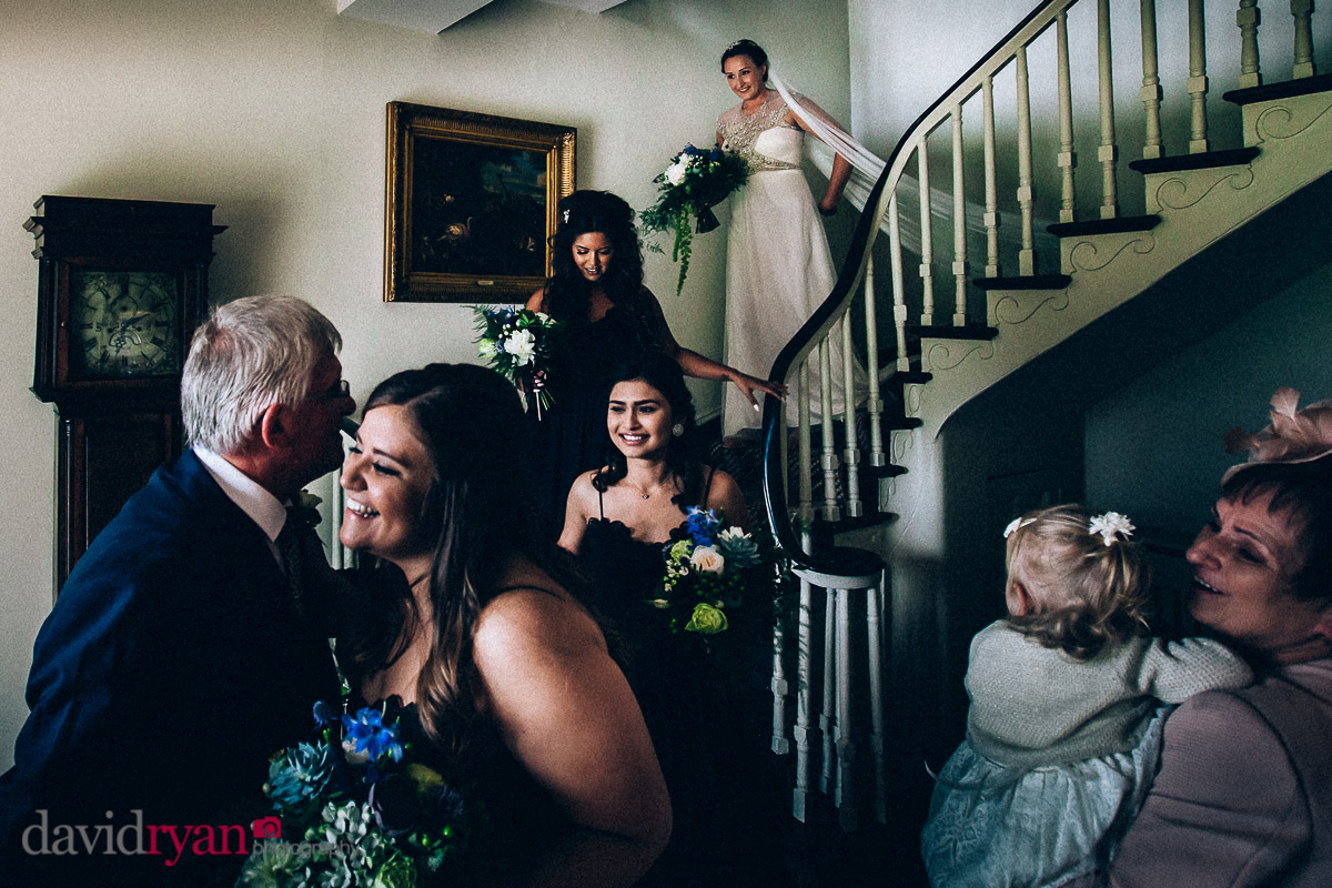 bride coming down a stairs