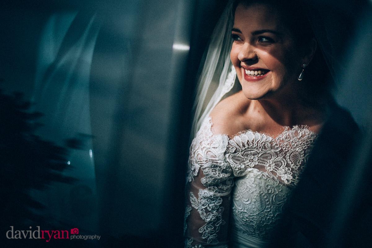 bride arrives at church in car