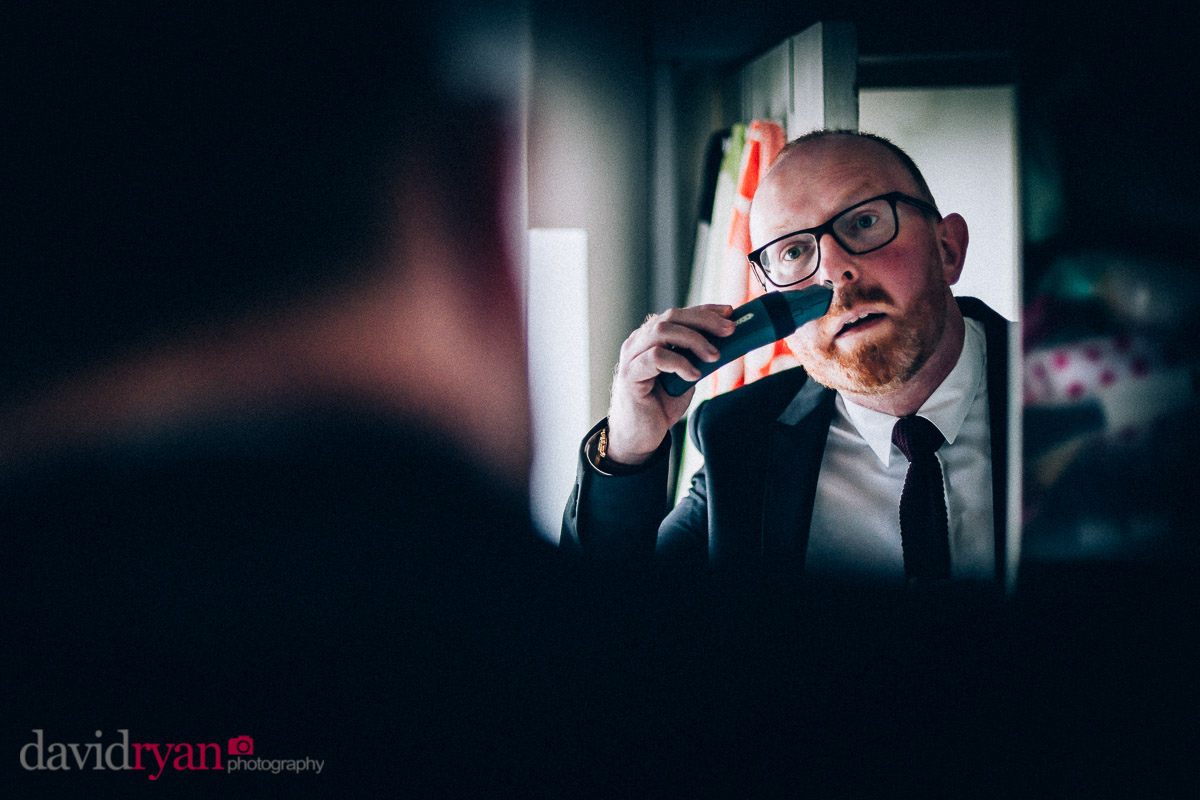 groom shaves his beard