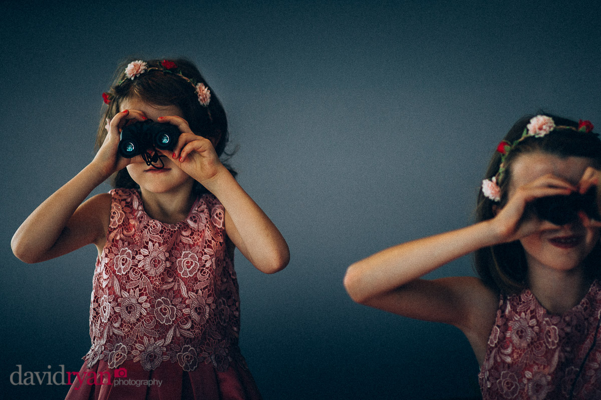 two girls with binoculars