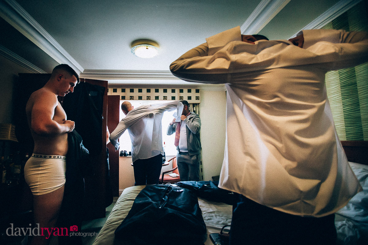 boys putting shirts on