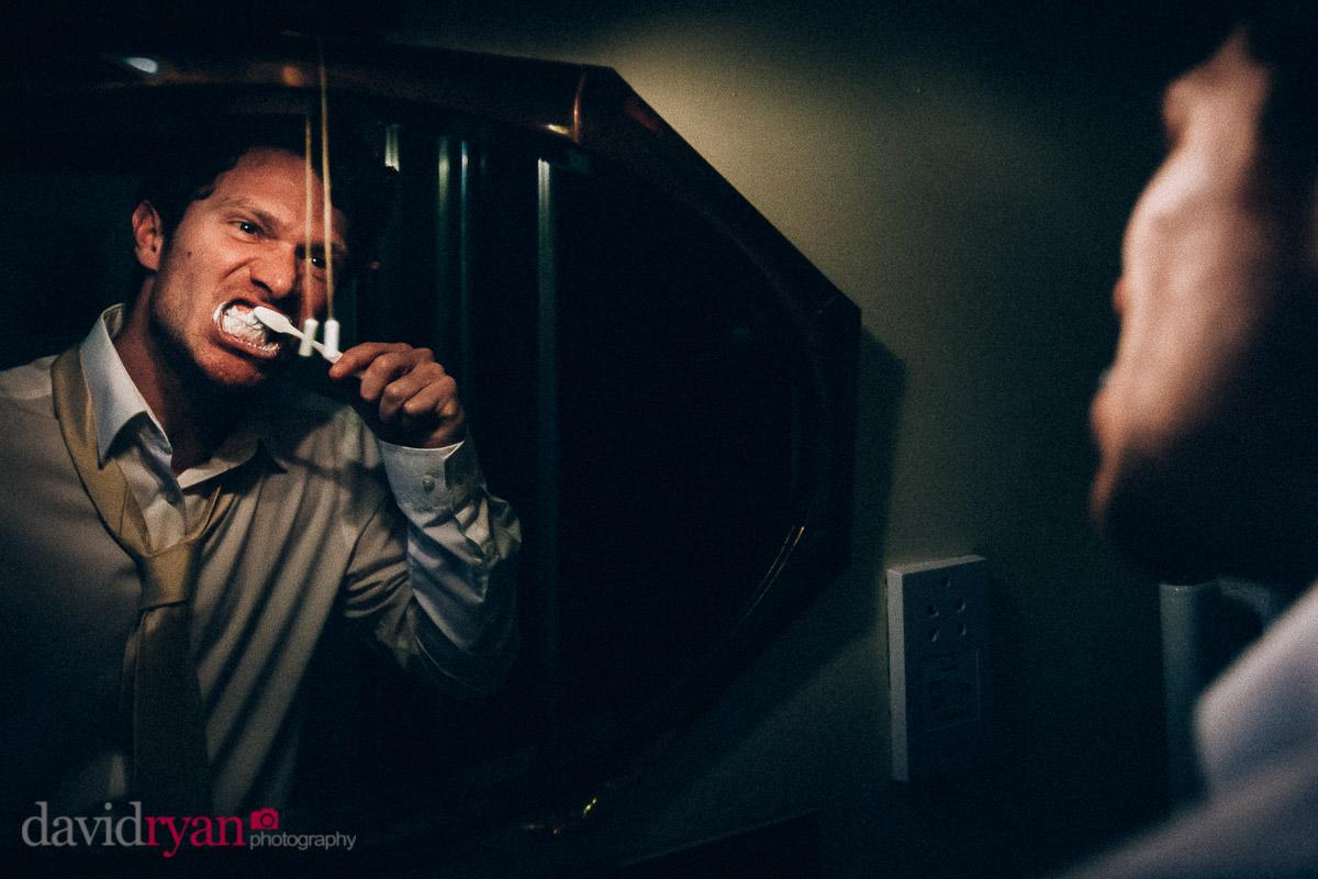 groom brushing teeth