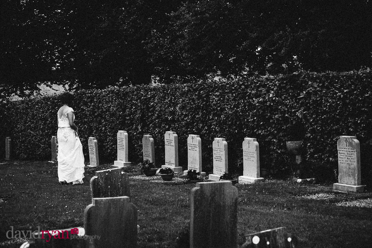 bride visting her father's grave