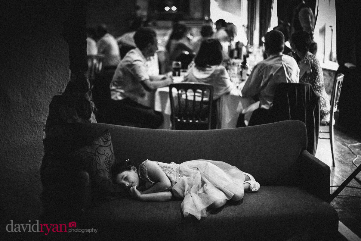 little girl sleeping on a couch