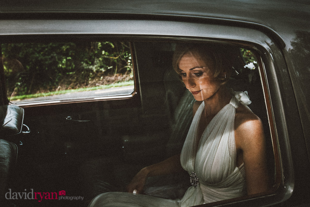 bride sitting in wedding car