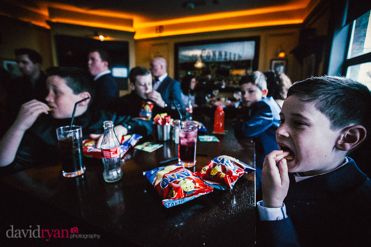 boys eating crisps