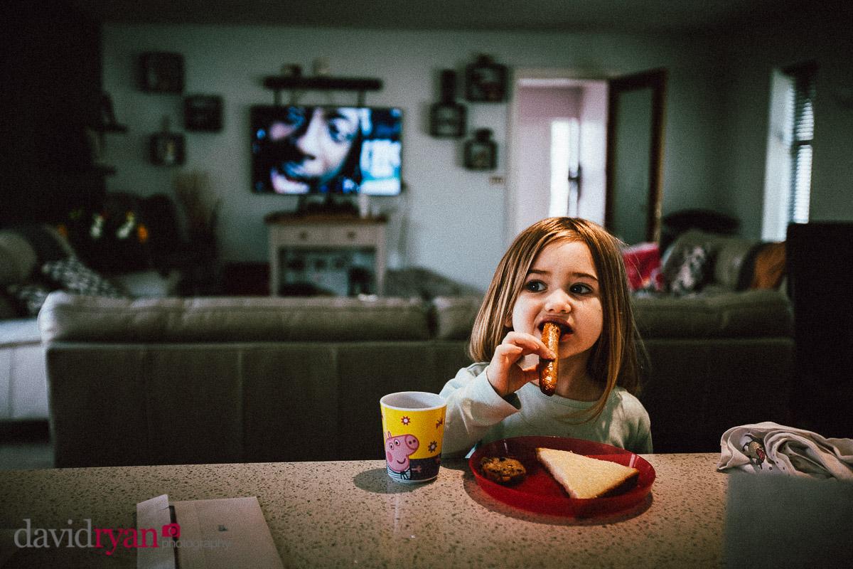 girl eating sausage