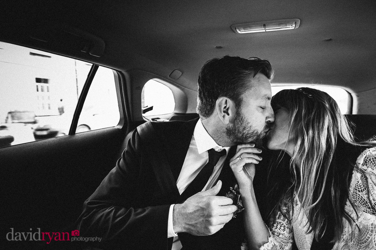 couple kissing in a taxi