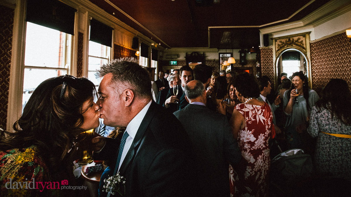 a couple kissing in a pub