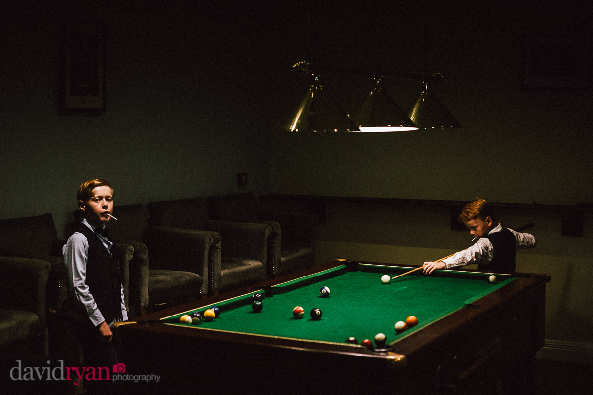 boys playing pool
